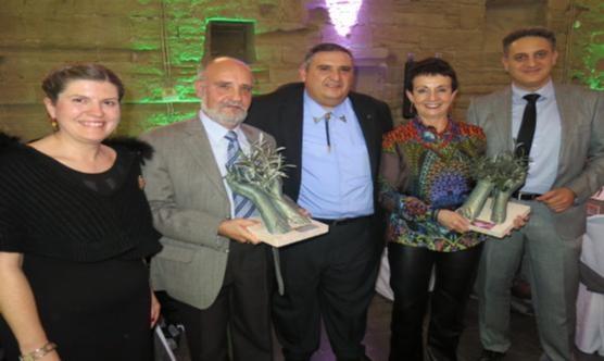 El president del CPC Lleida -al mig- amb els premiats.